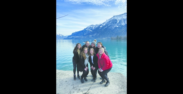 Madi Frideres (with stocking hat on) is shown with a group of friends at Lake Brienz in Interlaken, Switzerland, where they traveled for a weekend while studying abroad.